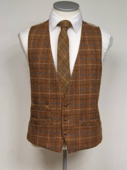 Brown genuine Harris Tweed Classic Wool Waistcoat 3 button, low cut style with a ticket pocket. Waistcoat - £98.00 to buy Matching Tie - £39.95 to buy