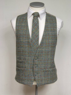 Green genuine Harris Tweed Classic Wool Waistcoat 3 button, low cut style with a ticket pocket. Waistcoat - £98.00 to buy Matching Tie - £39.95 to buy